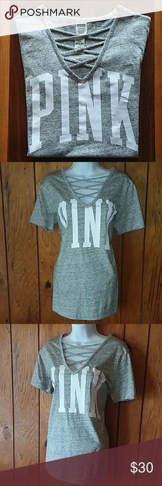 PINK Tee NWT PINK V-neck criss cross in V. Adorable gray oversized PINK tee, new with tags. Being it is oversized it would certainly fit a medium although the tags are x-small. Pretty firm on the price unless bundling as it is perfectly new! PINK Tops Tees - Short Sleeve