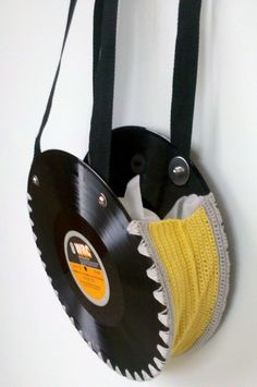 Vinyl Record Bag. I quite like this but I think the fixings on the handles need to be a bit finer and the colours on the crochet are fairly ghastly, I like the edging to fix to the record but I would do a fabric band