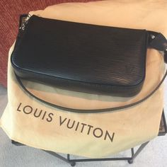 "Pristine Condition LV POUCHETTE Epi Black Leather. Final Reduction!  AUTHENTIC Absolutely Amazing Louis Vuitton Epi Noir Leather POUCHETTE in Perfect Pristine Condition! Dimensions are 9.1"" x 5.1"" x 1.6"". Shoulder carry with removable strap. Zip closure. Shiny silver metallic pieces. 1 interior pocket. Microfiber lining. Absolutely perfect condition! No trades!! No discounts!! Price is firm for this exceptional condition! Dust bag inc. Louis Vuitton Bags Mini Bags"