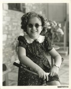 Miss Shirley Temple in her shades..