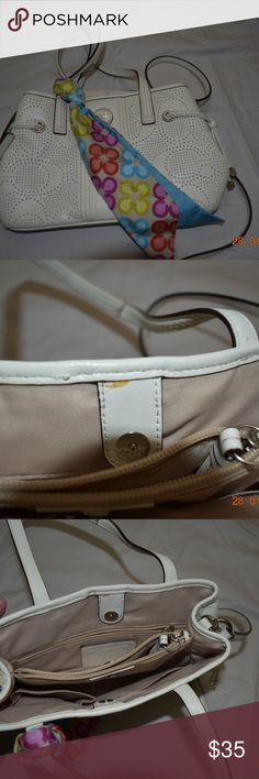 """Coach Handle bag w/Crossbody Strap Coach Winter White 3 compartment handbag.  """"Coach"""" is perforated into the leather.  Two sections close with magnetic snaps and the middle section closes with a zipper.  There is 1 open pocket and 1 standard Coach zippered pocket.  There is a stain on the inside of the back section.  I believe it is discolored glue used in the manufacturing process.  The vibrant scarf add the right amount of Pop to this lovely bag.  The dimensions are: 11"""" wide, 7"""" tall and…"""