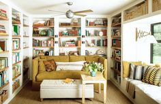 Get creative when it comes to storage areas and places to carve out more useable square footage. Incorporating floor-to-ceiling shelving, utilizing the space above the window frame, and adding built-in seating maximizes the functionality of this small family room. Placing a sofa in front of the bookcases enables for unexpected, hidden storage on the shelves behind it.
