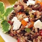 Mediterranean Brown Rice Salad - This Mediterranean-inspired salad combines brown rice with red bell peppers, raisins, olives, and feta cheese. It is tossed with a simple balsamic vinaigrette for a lunch or dinner salad.