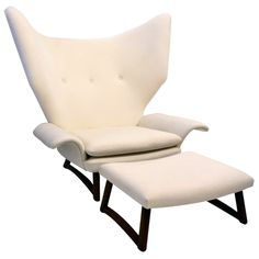 Fit for a King, 1951 Danish Chair & Ottoman  Denmark  1950's  This unique chair and ottoman was given as a gift by the director of Illums Bolighaus to a friend, in 1951. Although we do not know the designer, we do know it is one of a kind. It has a sweep unlike any other chair we have seen.