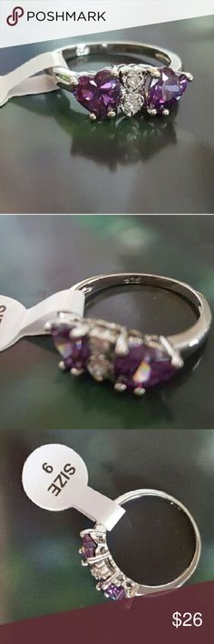 NEW LISTING: 925 Amethyst & White Topaz Ring NWT 925 Sterling Silver ring with heart shaped amethysts and white topaz in the center. Size 9. Brand new. Jewelry Rings