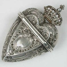 Silver heart vinaigrette. A small decorative bottle or container with a perforated top, used for holding an aromatic preparation such as smelling salts