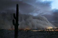 A monstrous sandstorm one mile high and 100 miles wide descends on the Phoenix, Arizona area on July 5, 2011