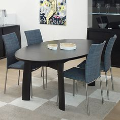 "Skovby Ellipse Extending Dining Table http://www.smartfurniture.com/products/Skovby-Ellipse-Extending-Dining-Table-SM-71.html; seating for 6 when unextended, 8 when extended; 2 folding leaves stored under the tabletop; leaves are revealed when table is extended; solid wood or veneer; {see video}; Overall: 43""d x 75-114""w x 29""h."