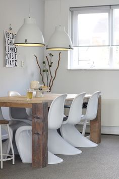 Love the chairs and industrial white pendants.