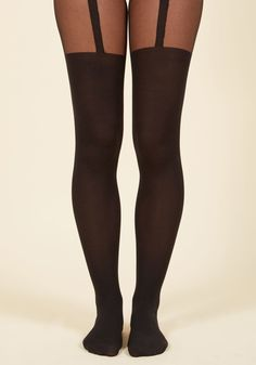 <p>Dive into a whole new world of style with these opaque black tights. Featuring sheer panels at the thighs with faux garter straps, this sassy pair adds an air of allure to your favorite ensembles. So, take the plunge and add this chic hosiery to your wardrobe!</p>