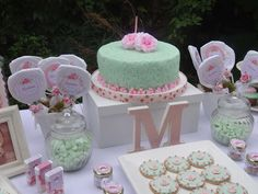 Pink and mint cake and favors at a shabby chic birthday party! See more party ideas at CatchMyParty.com!