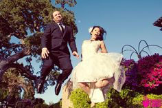 fun jumping wedding photo by truelovephoto.com