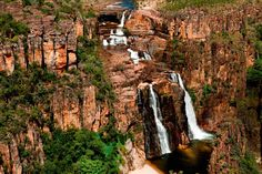 "Twin Falls, Kakadu, NT, Australia   ""See Jim Jim and Twin Falls at their thundering best during the wet season. Kakadu National Park comes alive during the wet and a bird's eye view is the best way to witness the spectacular World Heritage-listed National Park."" – Sally Cope, Wildman Wilderness Lodge"