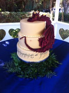 Lord of the rings wedding cake with elvish script and a giant Smaug the dragon!