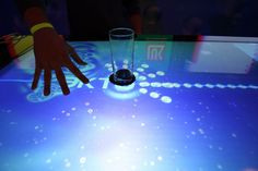 iBar- this is an interactive bar... you can have tv, internet, and games on it. You can customize the color and what it does when you touch it or set a glass down.