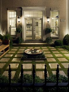 A grid floor and copper water feature centerpiece adorn this small viewing garden, classically arranged with modern underpinnings.
