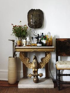 Stunning gold bar with eagle figurine and concrete base. @jerem