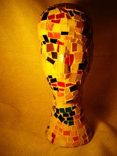 Recycled stained glass mosaic on found object