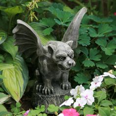 Classic Gargoyle statue protecting the plants, fairies, gardeners, passing insects and such.