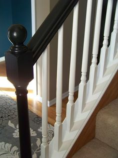 definitely need a mini makeover in our foyer - front door and banisters need some black paint!