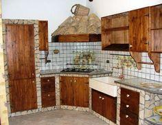 Cucina in muratura con piastrelle in terracotta e top in pietra lavica con lavello in pietra - Cucina rustica in pietra ...