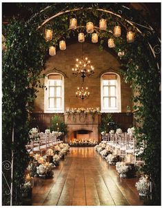 Wedding décor idea - bring the indoors in with a wedding arch covered in foliage.