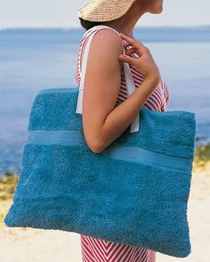 Upcycle thrifted towels into a beach bag/carry-all. Would be really need to be able to unfold and turn into a towel again.