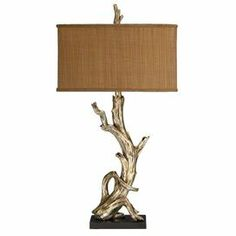 """Driftwood-inspired table lamp.    Product: Table lamp       Construction Material: Fabric and driftwood   Color: Natural and brown    Accommodates: (1) 100 Watt medium base bulb - not included     Dimensions:  34.75"""" H x 18"""" W x 9"""" D"""