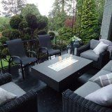 Large outdoor fire pit coffee table in modern Black and Stainless Steel and reflective fireglass.