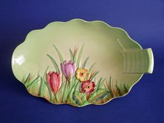 A lovely Carlton Ware dish in green Crocus Great colours and in excellent condition No chips cracks crazing or restoration Rare to find in such good
