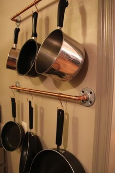 Maybe I'll do the double bar next to the window...Copper Pipe Pot Rack by DebraTefft