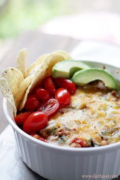 Taco Casserole  Layers of tortillas filled with a mixture of ground beef, greens, tomatoes and cheeses.