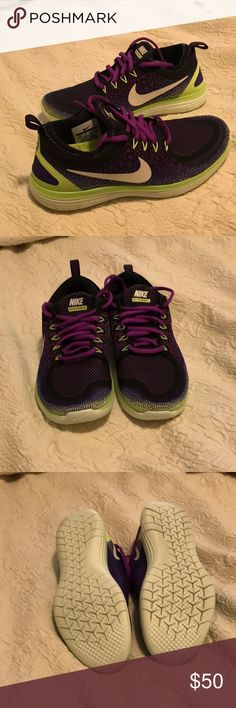 Women Nike Free size 7.5 Only worn once beautiful green, purple and black Nike running shoes. Nike Shoes Athletic Shoes