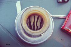 The slight ripple on coffee surface.