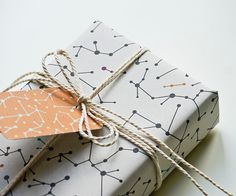 Ecofriendly Wrapping Paper White Molecules Set of 2 by MOZAIQ, $7.00