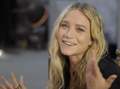 OLSENS ANONYMOUS MKA MARY KATE ASHLEY OLSEN FASHION STYLE BLOG BIK BOK VIDEO MK MARY KATE OLSEN SMILING LONG BLONDE WAVY HAIR NATURAL SIMPLE BEAUTY RINGS 3 photo OLSENSANONYMOUSMKABIKBOKVIDEOMKSMILING3.png