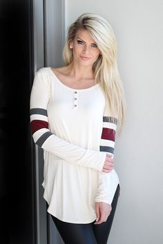 Get this cool Cream Top With Color Block Sleeves from Saved by the Dress Boutique. Stylish, yet sporty and comfortable cream top that features burgundy stripes!