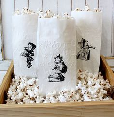 Choose your design, bags are sold in sets of 6 bags of the same design only. Please do not request for a mixed set. Size: Approx 10 x 3.5 White paper bags Image is hand stamped in black ink only