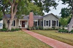 After. Kelsey and Trip Purks purchased this '40s era home in the Highlands neigborhood of Waco. Fixer Upper's Chip and Joanna Gaines replaced the original white paint paint with a gray-green exterior accented by white trim and black shutters. They retained the original wide Dutch doors, painted them to mimic the look of dark-stained wood, and added an antique brick-paver walkway to match the chimney.