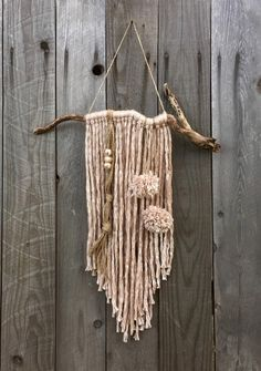 The driftwood on this yarn wall hanging measures 20in.