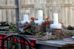 If you want to go full-on rustic this season, use slices of wood as candle bases on a sanded plank table with a vivid plaid blanket for a tablecloth. Notice how the slices of trunk are different heights to add interest to the grouping.