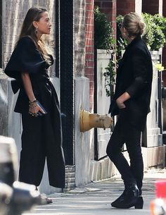 Mary-Kate and Ashley having a break from work outside their office in NYC on October 20, 2016