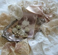 Fripperies:  Vintage lace and bling.