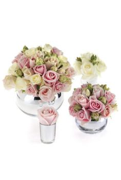 Individual tablecentres of 'Sweet Avalanche' and 'Avalanche' roses by Robbie Honey