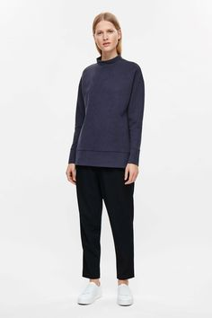 This high-neck sweatshirt is made from a soft cotton-mix. An oversized fit and cocoon shape, it has dropped shoulders, graduated hemline and wide brimmed finishes. Cos Shorts, Cos Tops, Oversized White Shirt, Cut Sweatshirts, Black Trousers, White Shirts, Normcore, Casual, Essentials