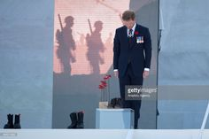 Britain's Prince Harry lays red poppies, at the Canadian National Vimy Memorial during a commemoration ceremony to mark the 100th anniversary of the Battle of Vimy Ridge at the Canadian National Memorial in Vimy, near Arras, northern France on April 09, 2017. (Photo by Philip Rock/Anadolu Agency/Getty Images)