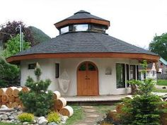 Octagonal straw bale house--guest house. Guttering to rain-water collection to run sinks, gray-water sumps, composting toilet, passive solar, low energy lights and wood heat.