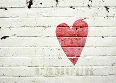 "Paint a mint heart on my white brick wall..with the words ""Love is Kind"" painted inside the heart."