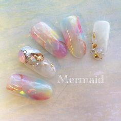 These nails look similar to Jamberry wraps called Coachella. The swirly unicorn/mermaid/cotton candy colors are perfect!    It would be easy to add some bling to Coachella to recreate this look.
