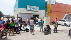 Dos pistoleros asaltan banco ADEMI en La Vega; hieren de bala vigilante
